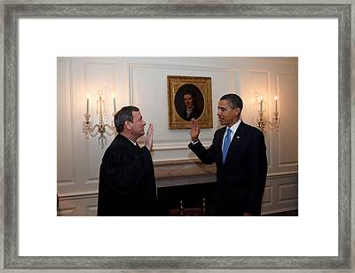 President Obama Is Given The Oath Framed Print by Everett