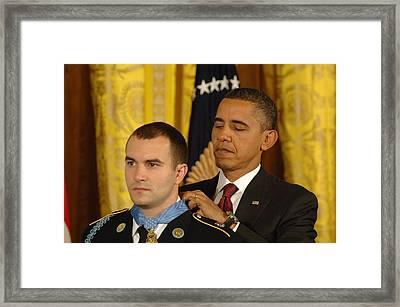 President Obama Presents The Medal Framed Print by Everett