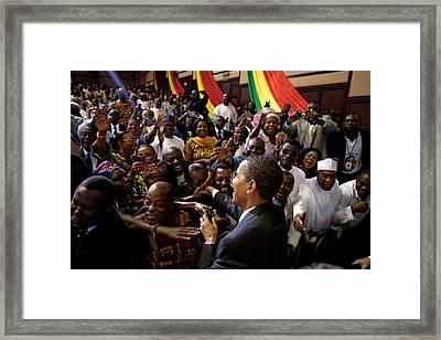 President Obama Shakes Hands Framed Print by Everett