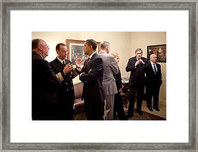 President Obama Talks With Admiral Framed Print by Everett