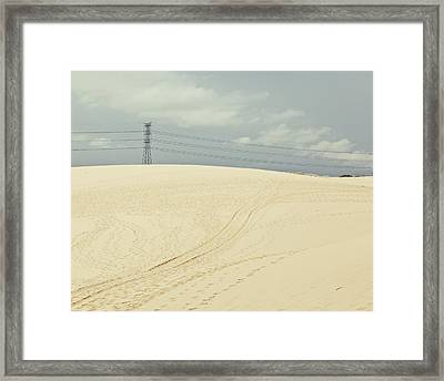 Pylon Atop Sand Dune Framed Print by Photograph by Chris Round