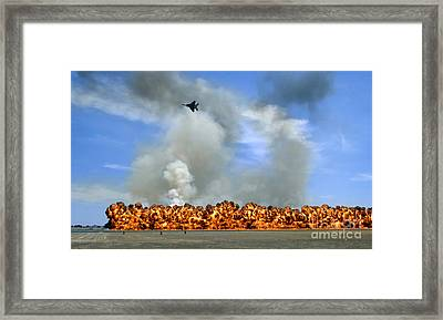 Pyrotechnics Explode While An F-15 Framed Print by Stocktrek Images