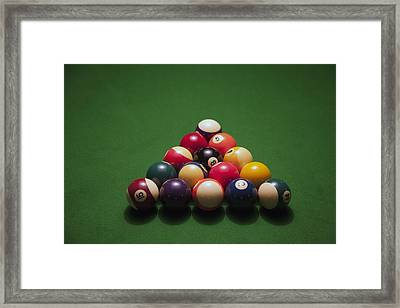 Racked Pool Balls On A Green Felt Pool Table Framed Print by Tobias Titz