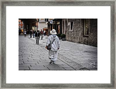 Rainwear In Salzburg Framed Print by Mary Machare
