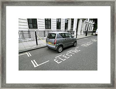 Recharging An Electric Car Framed Print by Martin Bond