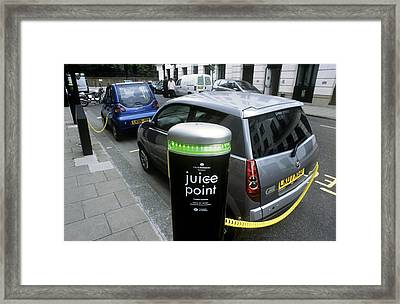 Recharging Electric Cars Framed Print by Martin Bond