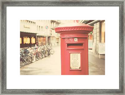Red English Post Box In Lucerne, Switzerland Framed Print by Copyright Laura Evans. All Rights Reserved.