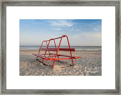 Red Park Bench On The Beach Framed Print by Jaak Nilson