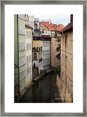 Red Rooftops In Prague Canal Framed Print by Linda Woods