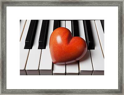 Red Stone Heart On Piano Keys Framed Print by Garry Gay