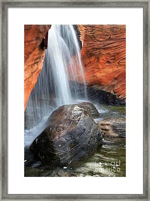 Red Waterfall Framed Print by Carlos Caetano