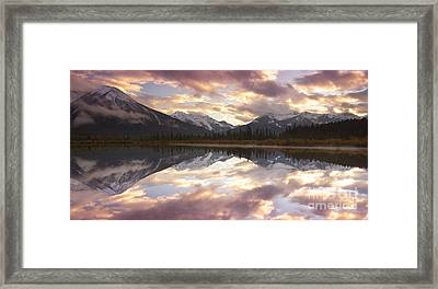Reflecting Mountains Framed Print by Keith Kapple