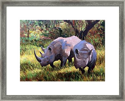Rhinos Grazing Framed Print by Roelof Rossouw