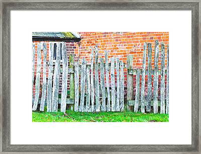 Rickety Fence Framed Print by Tom Gowanlock