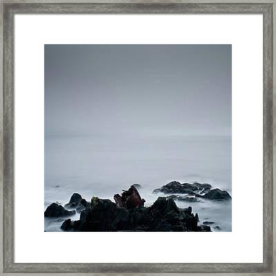 Rocks In Water At Sea Framed Print by Ahfox21