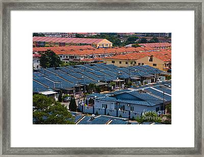 Rooftops Framed Print by John Buxton