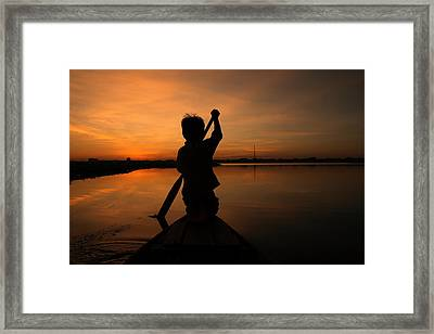 Rowing Into The Sunset Framed Print by Nabil Kannan