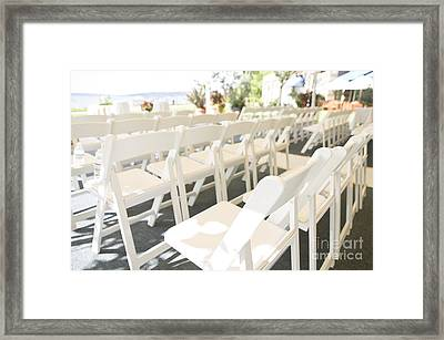 Rows Of White Folding Chairs Framed Print by Ned Frisk