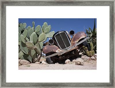 Rusted A Vintage Morris Eight Framed Print by Kent Kobersteen