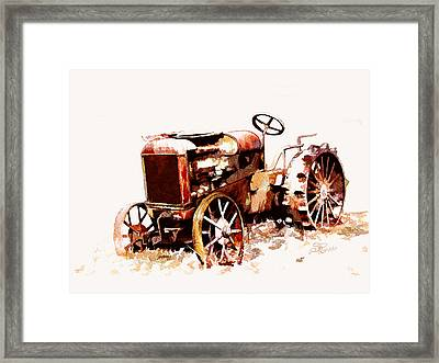 Rusty Tractor In The Snow Framed Print by Suni Roveto