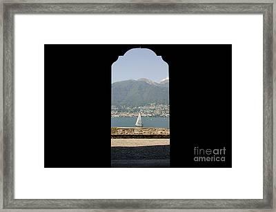 Sailing Boat Through An Open Door Framed Print by Mats Silvan