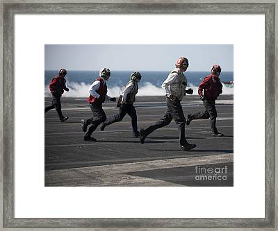 Sailors Clear The Landing Area Framed Print by Stocktrek Images