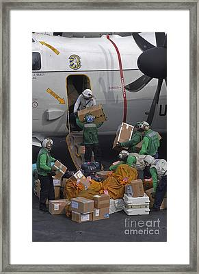 Sailors Load Mail On To A C-2a Framed Print by Stocktrek Images