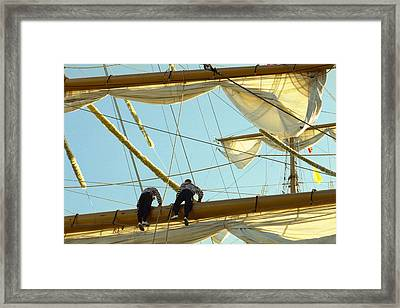 Sailors On Mast Framed Print by Marcio Faustino