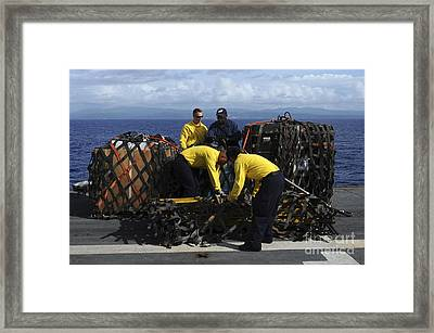 Sailors Prepare Pallets Of Cargo Aboard Framed Print by Stocktrek Images