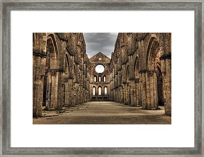 San Galgano  - A Ruin Of An Old Monastery With No Roof Framed Print by Joana Kruse
