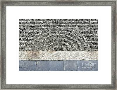 Sand Pattern In A Rock Garden Framed Print by Rob Tilley