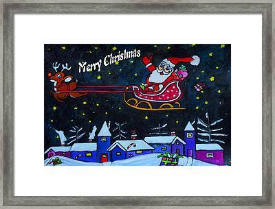 Santas Sleigh Ride Framed Print by Monica Engeler