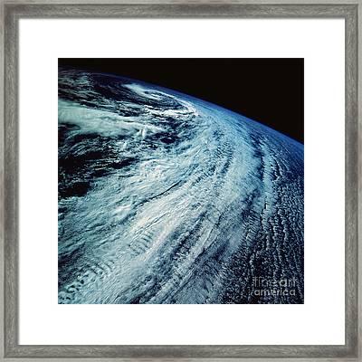 Satellite Images Of Storm Patterns Framed Print by Stocktrek Images