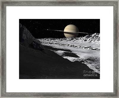 Saturns Moon, Tethys, Is Split By An Framed Print by Ron Miller