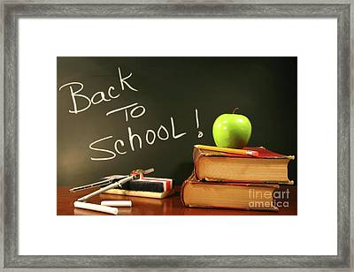 School Books With Apple On Desk Framed Print by Sandra Cunningham