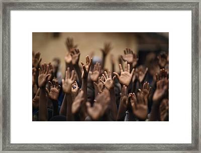 School Children Raise Their Hands Framed Print by Lynn Johnson