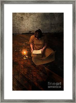 Schoolgirl Sitting On Wood Floor Reading By Candlelight Framed Print by Jill Battaglia