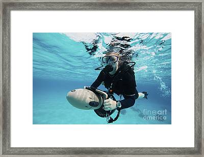Scuba Diver Navigates The Waters Using Framed Print by Terry Moore