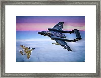 Sea Vixens At Play Framed Print by Chris Lord