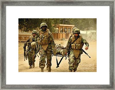 Seabees Conduct A Mass Casualty Drill Framed Print by Stocktrek Images
