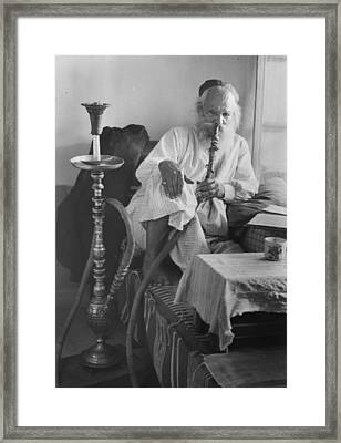 Seated Man Smoking A Nargile, Or Water Framed Print by Everett