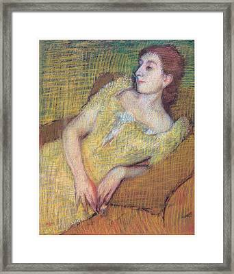 Seated Woman In A Yellow Dress Framed Print by Edgar Degas