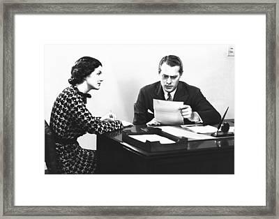 Secretary Assisting Businessman Reading Document At Desk, (b&w) Framed Print by George Marks