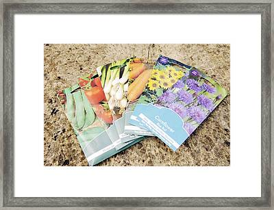 Seed Packs Framed Print by Johnny Greig