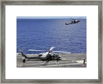 Sh-60 Sea Hawk Helicopters Land Aboard Framed Print by Stocktrek Images