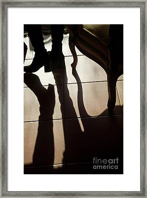 Shadow Of Woman's Foot And Furniture On Floor Framed Print by Sami Sarkis