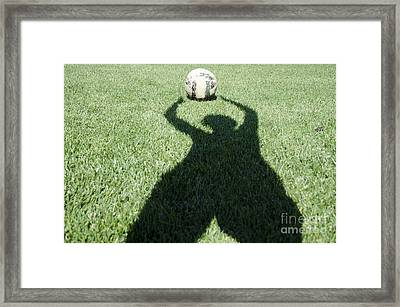 Shadow Playing Football Framed Print by Mats Silvan