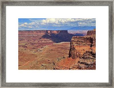 Shafer Canyon Overlook In Canyonlands National Park Framed Print by Louise Heusinkveld