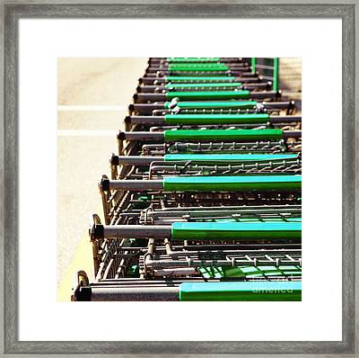 Shopping Carts Stacked Together Framed Print by Skip Nall