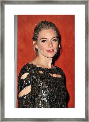 Sienna Miller Wearing A Balmain Dress Framed Print by Everett